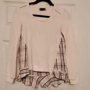 White sweater with plaid in back